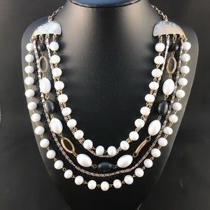Vintage seven strand gold, white, black necklace